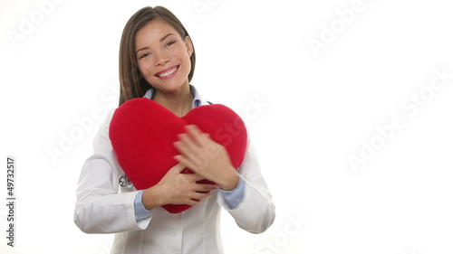 Medical doctor woman showing heart concept