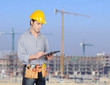 Construction worker writing paperwork