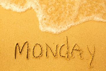 Monday - written in sand on beach texture(days week series)
