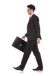 man walking with briefcase & looking away