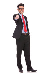 business man shows thumbs up