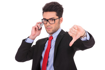 business man on phone shows thumb down