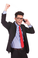 business man celebrates on the phone