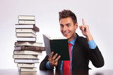 reading man has an idea at desk