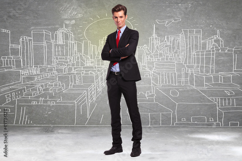 business man standing in front of a sketch of a big city