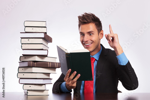 reading man has an idea at desk