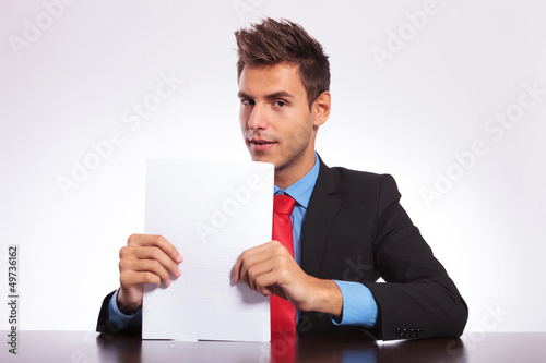 man at desk looks at you