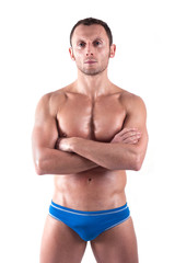 Young man wearing swimsuit isolated over white background.