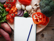 shopping list on table, with a bunch of vegetables