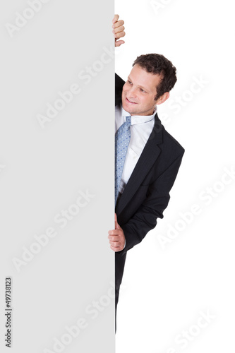 Successful businessman presenting empty banner