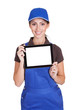 Smiling Female Plumber Holding Digital Tablet