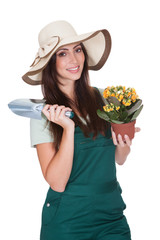 Pretty Woman Holding Plant And Gardening Shovel