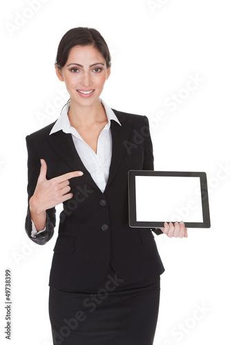 Smiling Businesswoman Holding Digital Tablet
