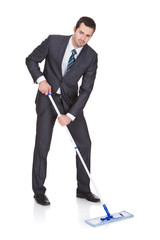 Businessman cleaning floor