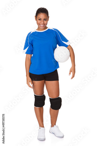 Young Girl Holding Volleyball
