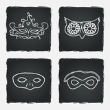 Carnival masks on chalkboard background.