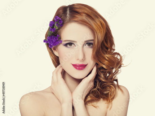 Redhead girl with flower, isolated.