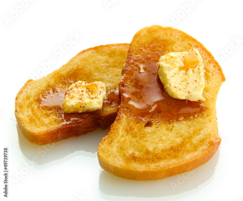 White bread toast with honey on plate, isolated on white