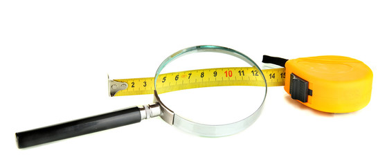 Tape measure with magnifying  glass isolated on white