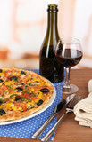 Tasty pizza with wine