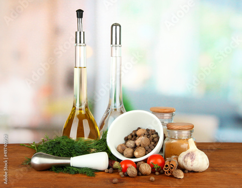 Composition of mortar, bottles with olive oil and vinegar, and