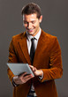 Young businessman touching a tablet screen.