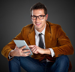 Young interesting businessman touching a screen tablet