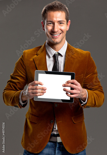 Young businessman showing a tablet screen.