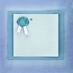 Greeting paper card with sealing wax stamp on blue background