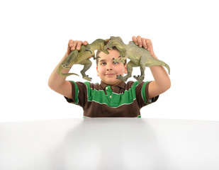 Cute boy playing with dinosaurs isolated on white background