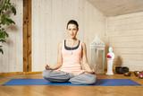 yoga woman siddhasana