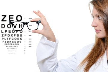 Optician giving a patient glasses to try on