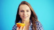 young beautiful woman holding oranges and smiling to camera