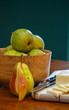 Cut Pear and Sliced Cheese with Bowl of Pears