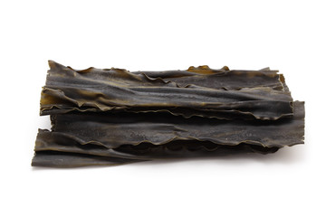 Kombu, sea vegetable on white background