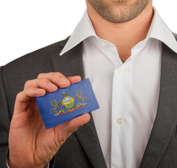 Businessman is holding a business card, Pennsylvania