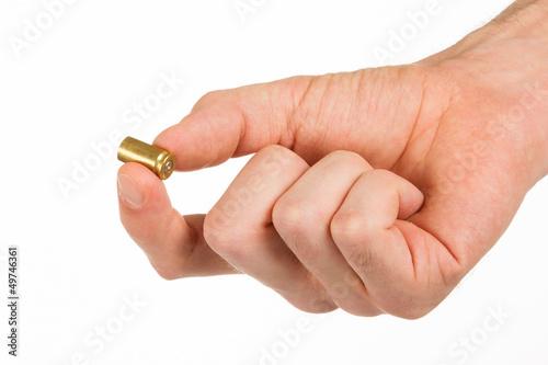 Hand holding an empty bullet shell