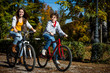 Urban biking - teens riding bikes in city