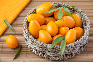 Kumquat in wicker basket