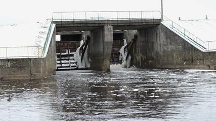 retro brick river dam ducks swim winter cold water