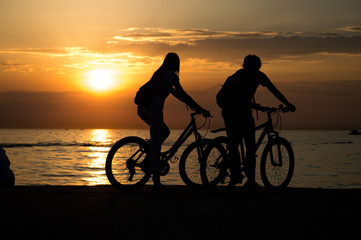 Bikers in Cloudy Sunset
