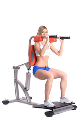 Sporty woman training on isodynamic exerciser