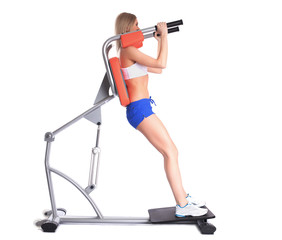 Sporty woman on isodynamic exerciser