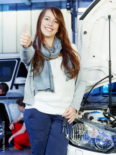 Customer is satisfied with the car service shows thumb up