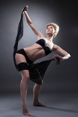 sexy woman dancing with black cloth