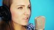 woman singing song at studio and looking at camera