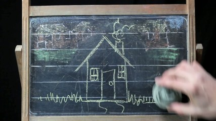 using eraser over a vintage blackboard