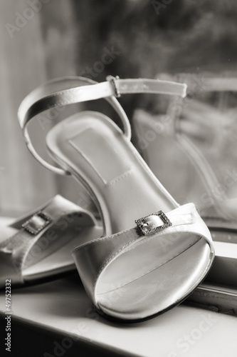 Bridal shoes at window in black and white