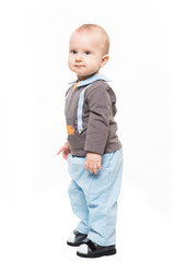 Cute baby boy standing isolated on white backgroung