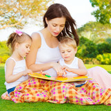 Little kids with mommy read book